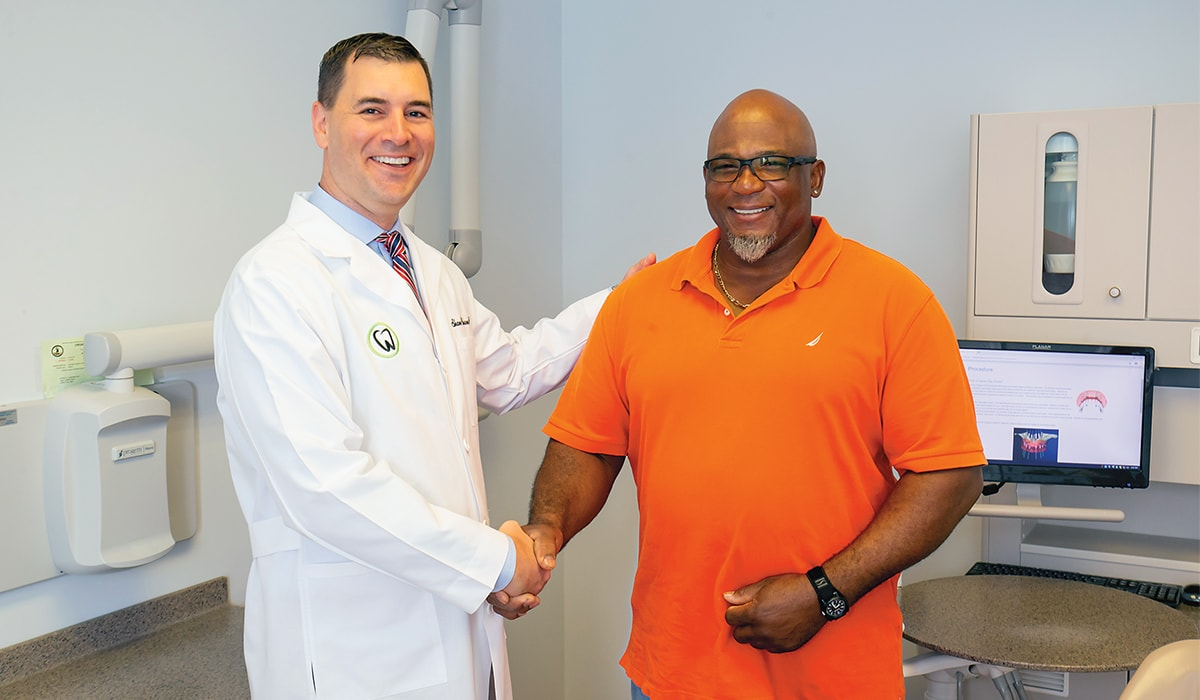 Dr. Claiborne with patient same day smile